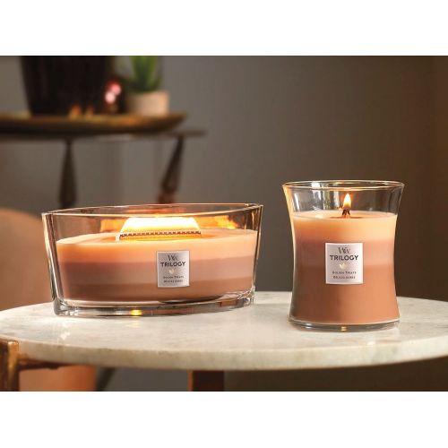 Vonná svíčka WoodWick Trilogy - Golden Treats 275 g
