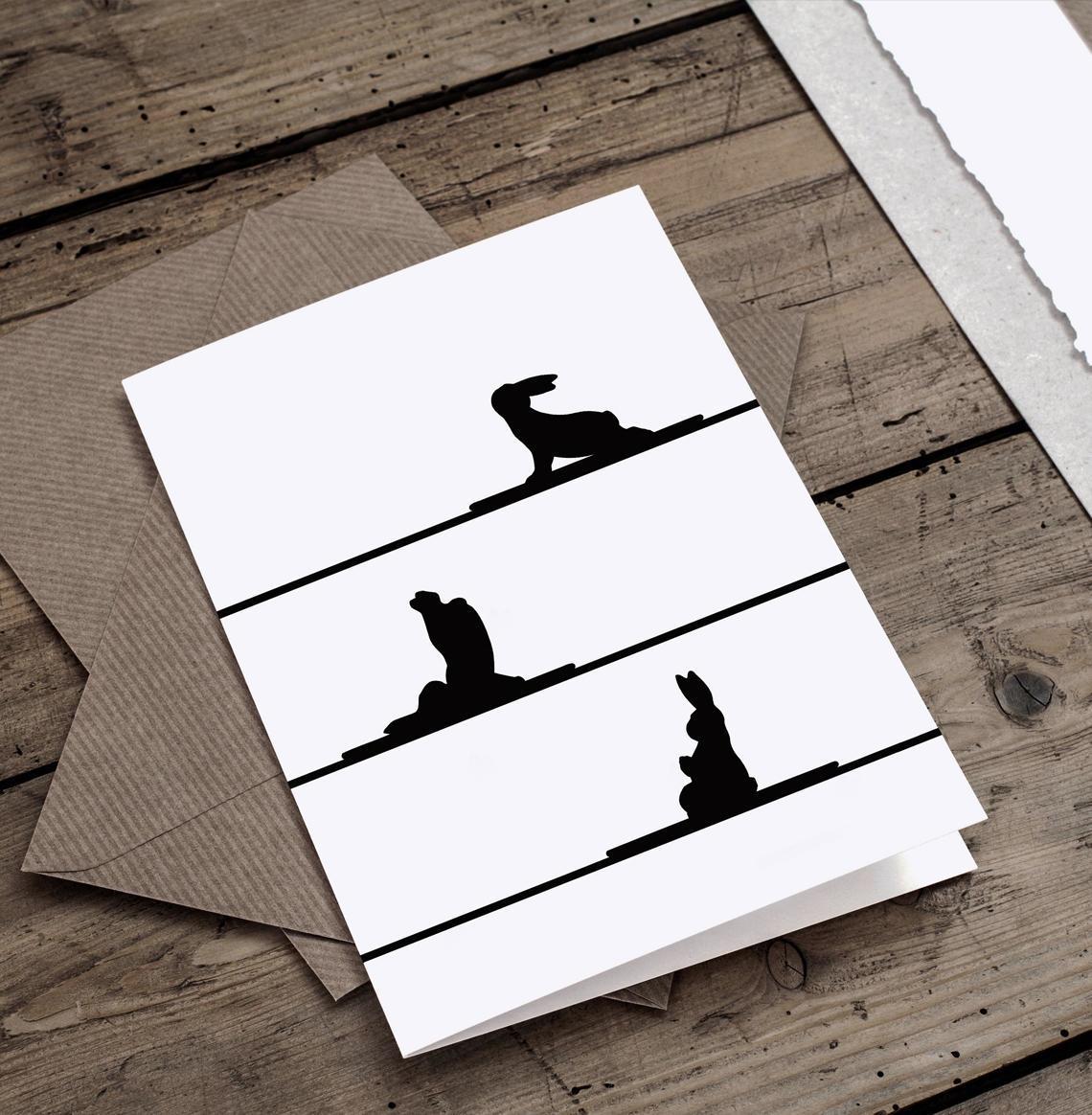 papírová přání k narozeninám Černobílé papírové přání se siluetami králíků cvičících jógu  papírová přání k narozeninám